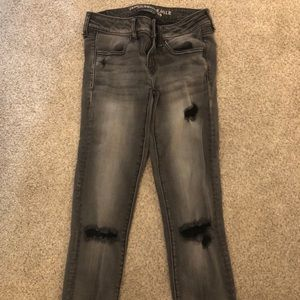 American Eagle grey skinny jeans with holes